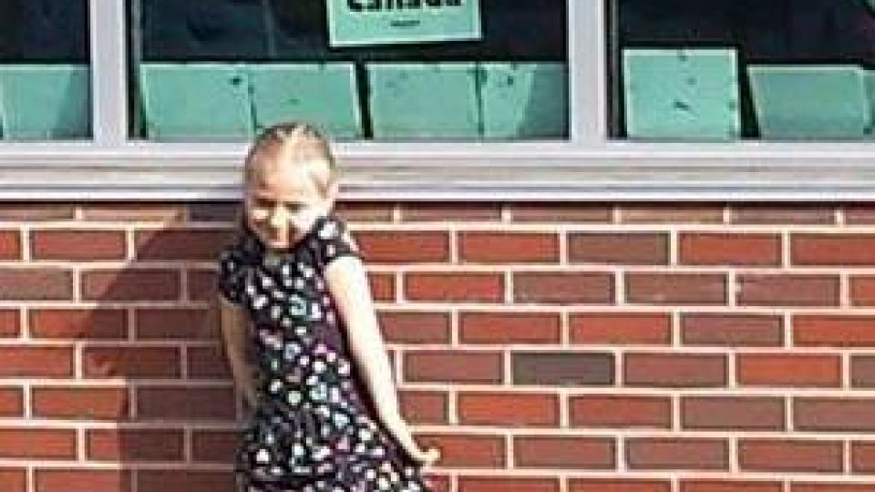 Charlottetown P.E.I. Little girl put a Save Canada Post at School