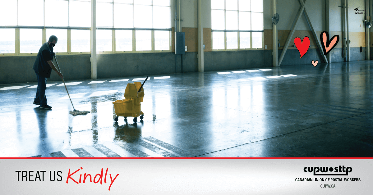 Photo of a cleaner mopping the floor of an empty warehouse.